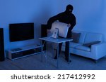 full length of thief stealing... | Shutterstock . vector #217412992