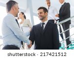businessmen shaking hands. two... | Shutterstock . vector #217421512
