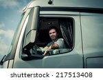 truck driver sitting in cab | Shutterstock . vector #217513408