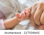 new born baby hand | Shutterstock . vector #217534642