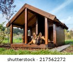 German Shepherd Resting In Its...