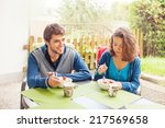 family eating outdoors | Shutterstock . vector #217569658