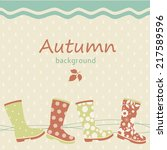 autumn background with gumboots | Shutterstock .eps vector #217589596