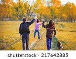 happy family with dog walking... | Shutterstock . vector #217642885