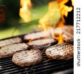 hamburgers grilling on charcoal ... | Shutterstock . vector #217712212
