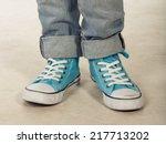 boy in blue sneakers standing | Shutterstock . vector #217713202