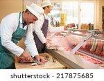 Two Butchers Preparing Meat In...