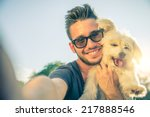 Stock photo young handsome man taking a selfie with his dog 217888546