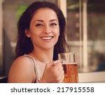 happy woman drinking beer in... | Shutterstock . vector #217915558