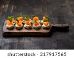 mini canapes with smoked salmon | Shutterstock . vector #217917565