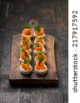 mini canapes with smoked salmon | Shutterstock . vector #217917592