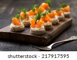 mini canapes with smoked salmon | Shutterstock . vector #217917595
