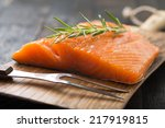 Smoked Salmon On Wooden Board