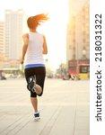 runner athlete running on city... | Shutterstock . vector #218031322