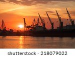 Silhouettes Of Cranes And...