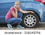 Woman With Flat Tire On Car...