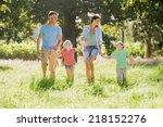 family enjoying walk in... | Shutterstock . vector #218152276