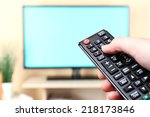 watching tv and using remote... | Shutterstock . vector #218173846