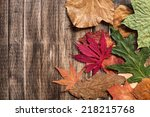 Autumn Leaves On Wooden...
