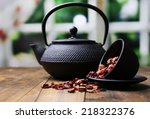 Black Teapot  Bowl And Hibiscu...