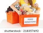 girl volunteer with donation...   Shutterstock . vector #218357692