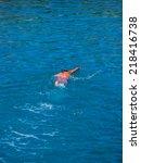 top view of a man snorkeling in ... | Shutterstock . vector #218416738