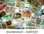 A mixture of various international paper currencies - stock photo