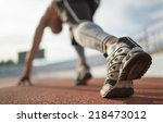 athlete runner feet running on... | Shutterstock . vector #218473012