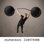 strong muscular man lifting... | Shutterstock . vector #218474488