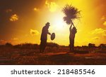 farmers silhouettes at sunset.... | Shutterstock . vector #218485546