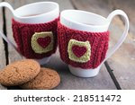 Knitted Woolen Cups On A Woode...