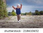 Cute Little Boy Running And...