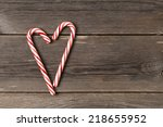 christmas candy canes on wooden ... | Shutterstock . vector #218655952