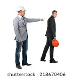 Small photo of Architect , builder or engineer admonishing his young partner pointing the finger of blame at him as he turns away dejectedly