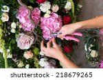 florist at work. woman making... | Shutterstock . vector #218679265