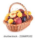 ripe summer fruits in a basket | Shutterstock . vector #218689102