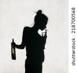 shadow of girl with cigarette... | Shutterstock . vector #218700568
