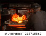 hot iron in smeltery held by a... | Shutterstock . vector #218715862