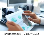 business person analyzing... | Shutterstock . vector #218740615