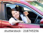 happy smiling woman in a car.... | Shutterstock . vector #218745256