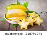 Star Fruit On Wood Background ...