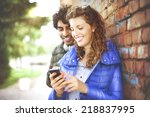 Couple Looking At A Mobile Phone