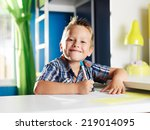 little boy doing homework in... | Shutterstock . vector #219014095