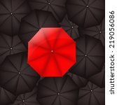 red umbrella against black... | Shutterstock .eps vector #219056086