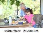 grandmother cooking apple pie... | Shutterstock . vector #219081325
