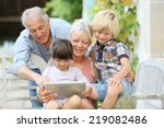 happy grandparents playing game ... | Shutterstock . vector #219082486