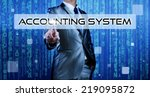 Small photo of Business man with digital background pressing on button accounting system