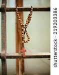 wooden rosary with the cross on ... | Shutterstock . vector #219203386