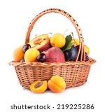 ripe summer fruits in a basket | Shutterstock . vector #219225286