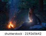 beautiful witch looking at the... | Shutterstock . vector #219265642